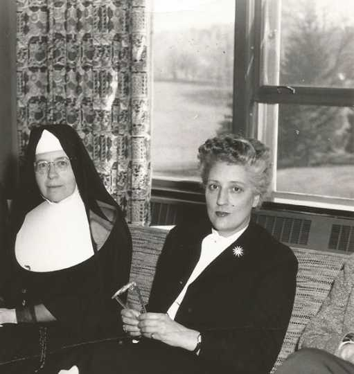 Black and white photograph of Alice Gustava Smith (Sister Maris Stella, left) with May Sarton (right), c.1958.