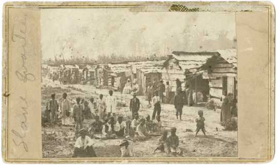Enslaved people and their homes, Helena, Arkansas; taken while Sixth Minnesota Volunteers were camped in Helena.