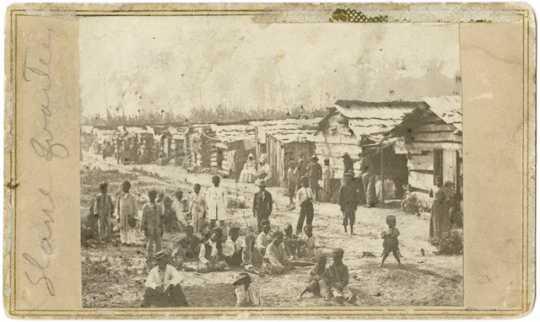 Enslaved people and their homes, Helena, Arkansas; taken while Sixth Minnesota Volunteers were camped in Helena.