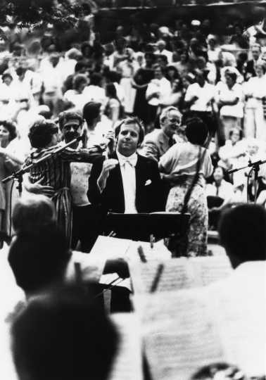 Black and white photograph of Leonard Slatkin at Sommerfest, c.1983.