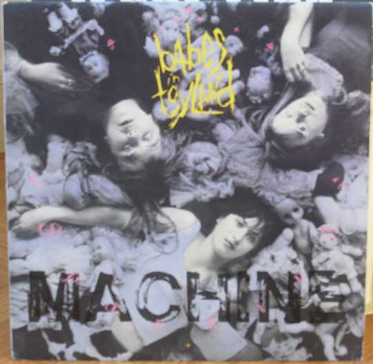 The cover of Babes in Toyland's 1991 debut album, Spanking Machine. The photograph on the sleeve shows (clockwise, left to right) Lori Barbero, Kat Bjelland, and Michelle Leon.