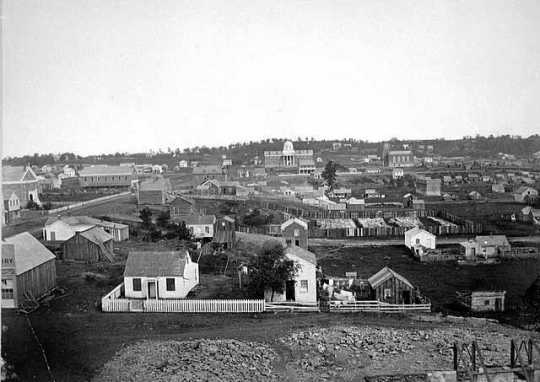 Black and white photograph of a view of St. Paul including the Capitol building, 1857.