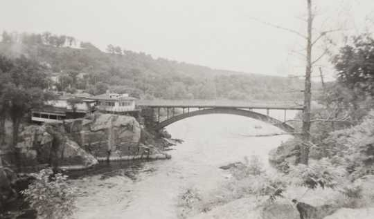 Black and white photograph of St. Croix River, Dalles of the St. Croix. Includes view of Showboat Inn and Interstate Bridge, 1905–1949.