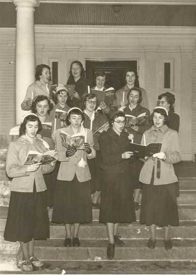 Black and white photograph of Holiday carolers at St. Joseph's Academy, c.1950.