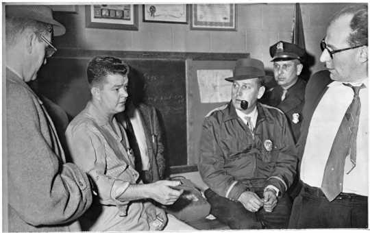 The president of the United Packing House Workers of America (UPWA) union Local 6, Charles Lee (second from left), with Freeborn County attorney O. Russell Olson (far left), sheriff Everette Stovern (third from right), police lieutenant Woodrow Chrz (second from right), and union lawyer Doug Hall (far right), 1959. Minneapolis Star Tribune portraits collection (news photos, box 108), Minnesota Historical Society.