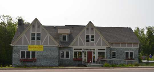 Color image of Stickney Inn and Store, north elevation, facing south, July 2014. Photographed by Amy Lucas.