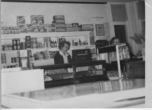 Black and white photograph of the interior of Stickney's grocery store, ca. 1950.