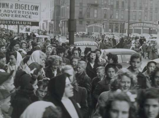 Black and white photograph of young people leaving concert, 1943.