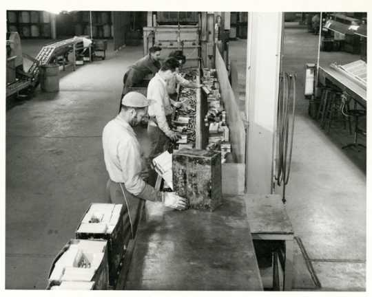 Workers on the factory line at the Twin Cities Ordnance Plant