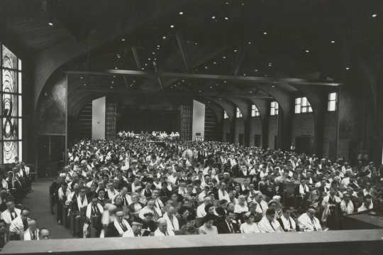 Black-and-white photograph of the interior of the Temple of Aaron during a worship service c.1960.