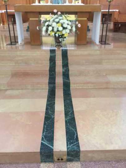 Floor decoration honoring Father Michael J. Casey