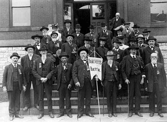 Black and white photograph of Brackett's Battalion veterans gathered for a Grand Army of the Republic Reunion, 1905.