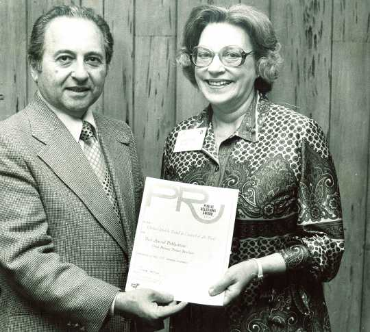 Black and white photograph of members of the United Jewish Federation Council receive a public relations award on November 24, 1978.