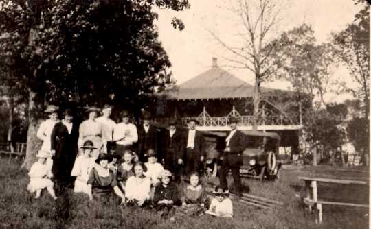 Black and white photograph of people in front of the Valhalla Island Resort pavilion on Lake Shetek, ca. 1920s.