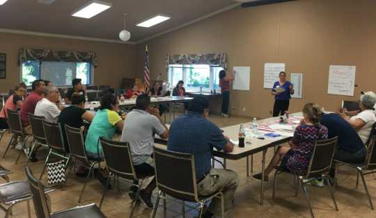Color image of MCLA staff visit Marshall, Minnesota, for a listening session with residents, 2017.