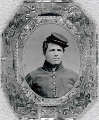 Photgraph portrait of Joseph Volk in his uniform, including his hat.