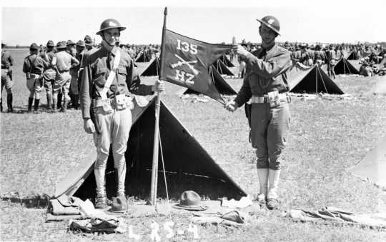 Black and white photograph of Moe Jones and Einar Lund of Stillwater's Howitzer Company, 135th Infantry, during a field inspection at Camp Ripley, 1935.
