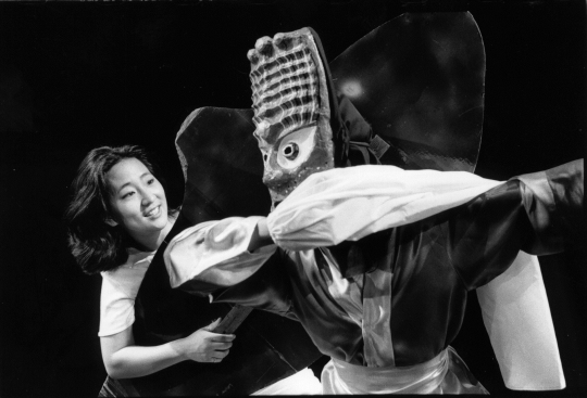 Color image of Shaman (Jennifer Weir) and Chwibari Dancer (Kaori Kenmatsu) in the Mu Performing Arts production of <em>Walleye Kid</em>, written by R. A. Shiomi and Sundraya Kase, directed by Rick Shiomi, 1998. Photographed by Charissa Uemara.