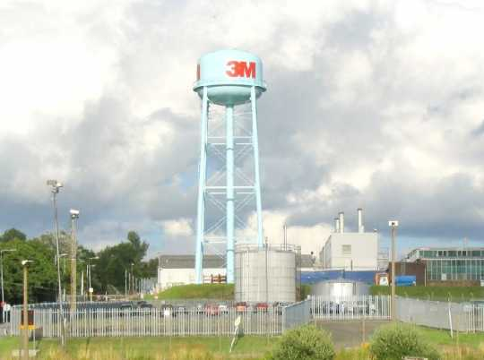 3M factory water tower, ca. 2001. Water towers were a visible part of 3M's large factory facilities. This water tower was located in Gorseinon, Wales, United Kingdom. Photograph by Wikimedia Commons user Nigel Davies.