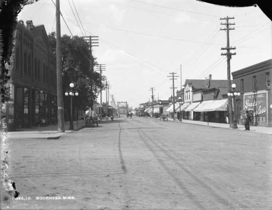 View (photograph) of Main Avenue from Fourth Street in Moorhead, ca. 1890s
