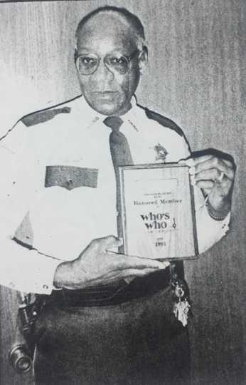 Photograph of John Lyght receiving an award