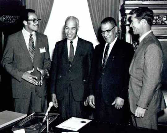 1975 Photograph of Roy Wilkins, Samuel Richardson, Governor Wendell Anderson and an unidentified man.