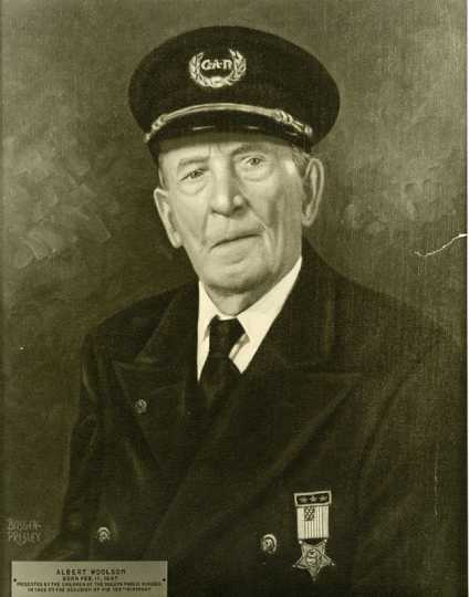 """Albert Woolson in his Grand Army of the Republic uniform. The plaque reads, """"Albert Woolson, Born February 11, 1847 [sic], Presented by the Children of the Duluth Public Schools in 1952 on the Occasion of his 105th [sic] Birthday."""" Photograph by Basgen-Presley, Duluth."""