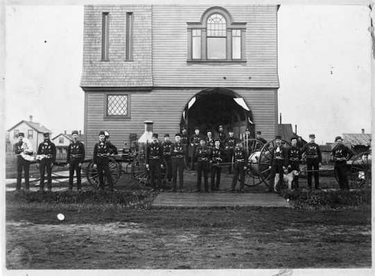 The Hinckley fire house, firemen, and Waterous steam fire engine, before September 1, 1894. The steam fire engine was manufactured in South St. Paul.