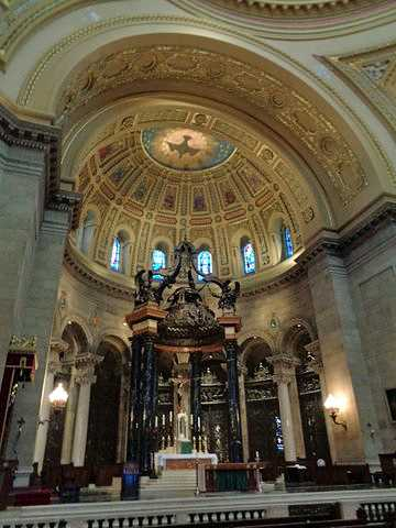Color image of the altar and baldachin (decorative canopy) inside the St. Paul Cathedral. Photographed by Paul Nelson on July 10, 2014.