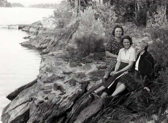 Black and white photograph of Frances E. Andrews (far right) and two other women, ca. mid-1950s.