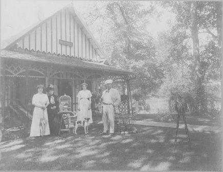 Photograph of four people in front of Villa Marie in Waconia. From left to right: Mrs. Emile Amblard; her mother, Mrs. Wood; Lillian Osterfelt; Mr. Emile Amblard.