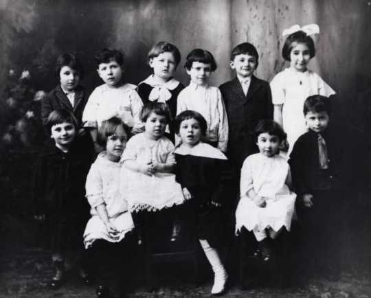 Black and white photograph of children attending a child's birthday party c.1912.