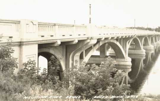 Black and white postcard image of the concrete Anoka–Champlin Mississippi River Bridge, ca. 1929.