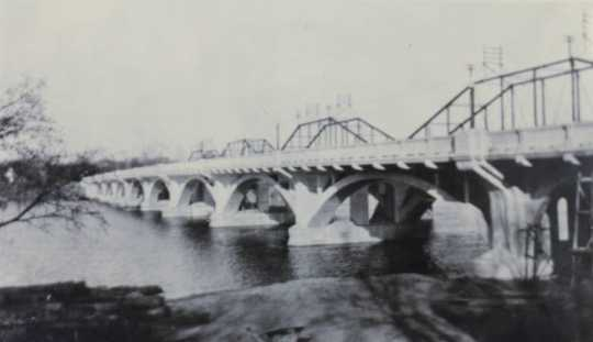 Black and white photograph of the Anoka–Champlin Mississippi River Bridge 4380, ca. 1930.