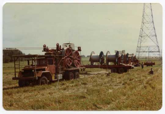 A drum puller and reels of cable being strung for the Cooperative Power Association, Minneapolis, Minnesota/United Power Association, Elk River, Minnesota high-voltage power-line construction through Grant County, Minnesota, 1976–1978.