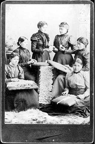 photograph of lace makers and their lace