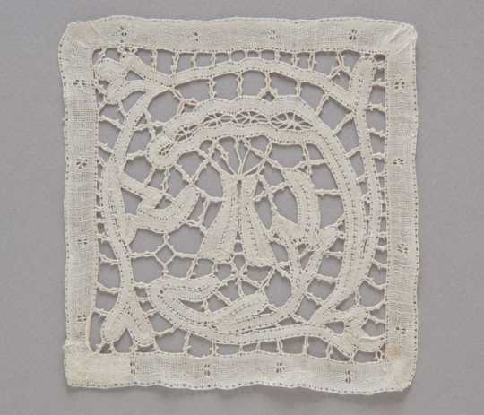 photograph of a lace doily featuring a tipi motif