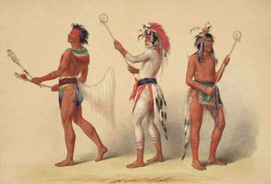 Native Americans with lacrosse sticks