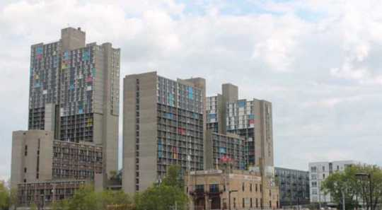 Color image of the he skyline of the Cedar-Riverside neighborhood of Minneapolis viewed from the north. At center are the Riverside Plaza complex of apartment buildings and Mixed Blood Theatre. Photograph by Ibrahim Hirsi, May 3, 2017.