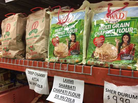 Color image of varieties of chapati flour on sale at Pooja Grocers. Photographed by Preeti Mathur in March 2017.