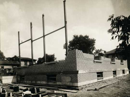 Black and white photograph of in-progress construction of the Anoka Post Office, July 5, 1916.