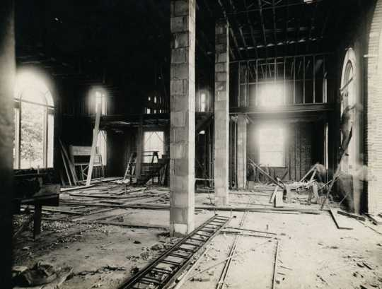 Black and white photograph of the lobby of the Anoka Post Office during construction, looking west, March 1, 1917.