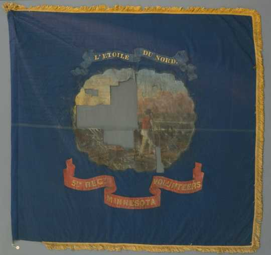 Blue silk battle flag with the state seal of Minnesota painted on the center