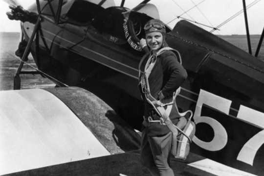 Black and white photograph of Klingensmith with one of her aircraft, a Waco biplane, ca. 1930.
