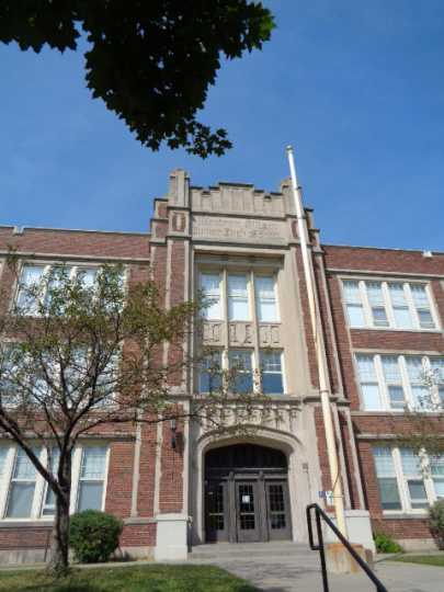 Color image of the front entrance of Wilson Junior High School in St. Paul designed by Clarence Wigington and built in 1924 and 1925. Photographed by Paul Nelson on August 15, 2014.