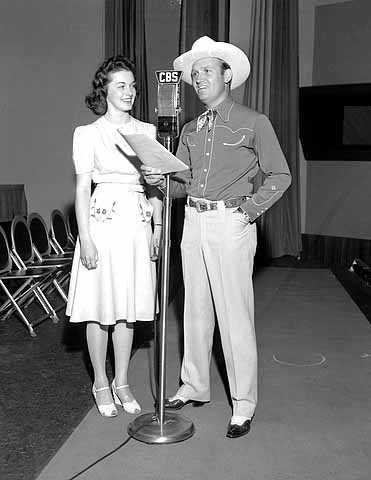 Queen of the Lakes Joyce Moen in Hollywood studios of CBS radio with Gene Autry.