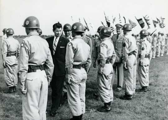 Black and white photograph of Governor Orville Freeman inspecting his troops at Camp Ripley, 1955.