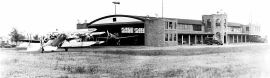 Black and white photograph of aircraft hanger at Camp Ripley, 1939.
