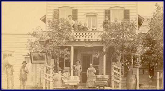 1878 Photograph showing the Helvetia General Store as well as members of the owner's family and other community members