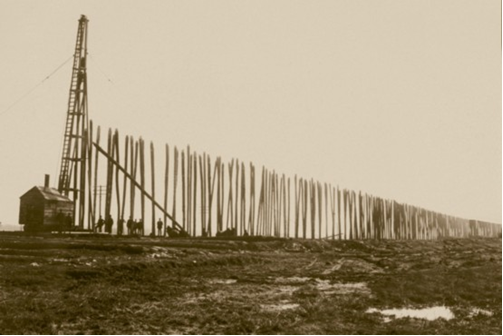 Black and white photograph of driving piles for the Stockwood Fill, spring 1906.